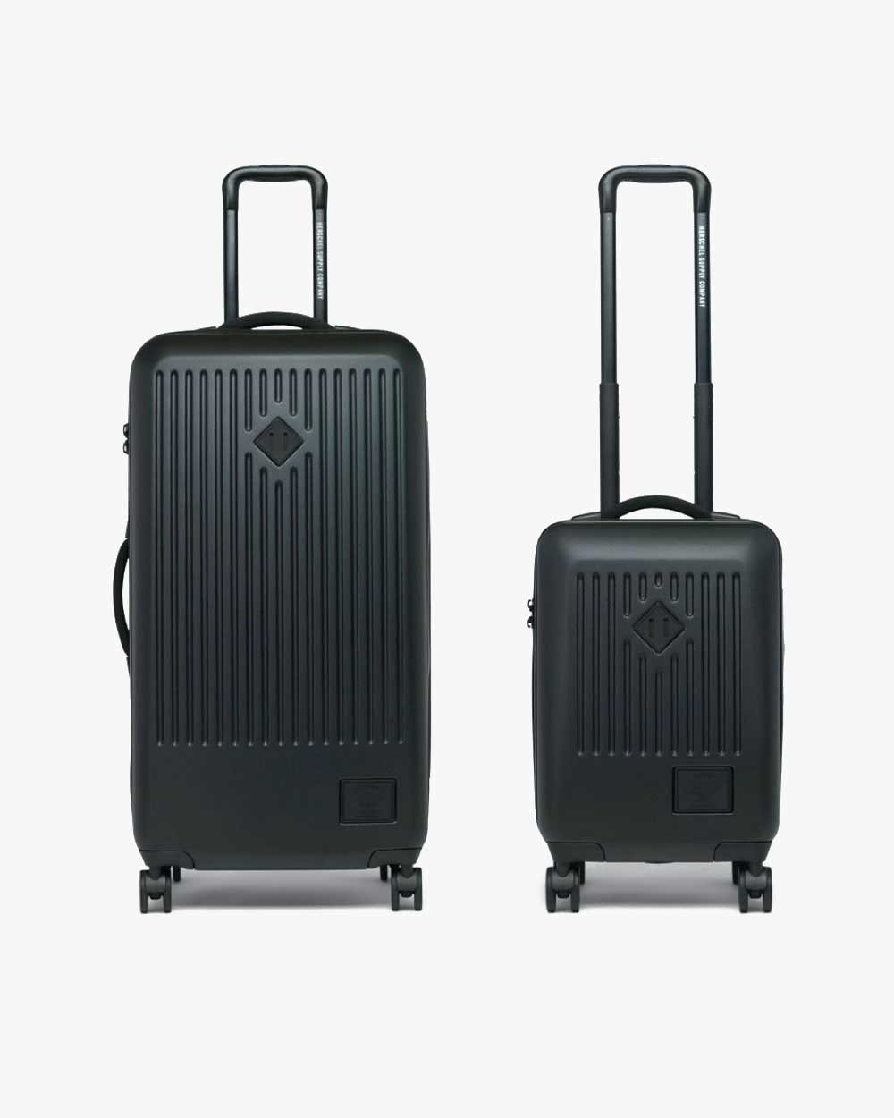 image of a black herschel trade large luggage and trade carry-on large luggage