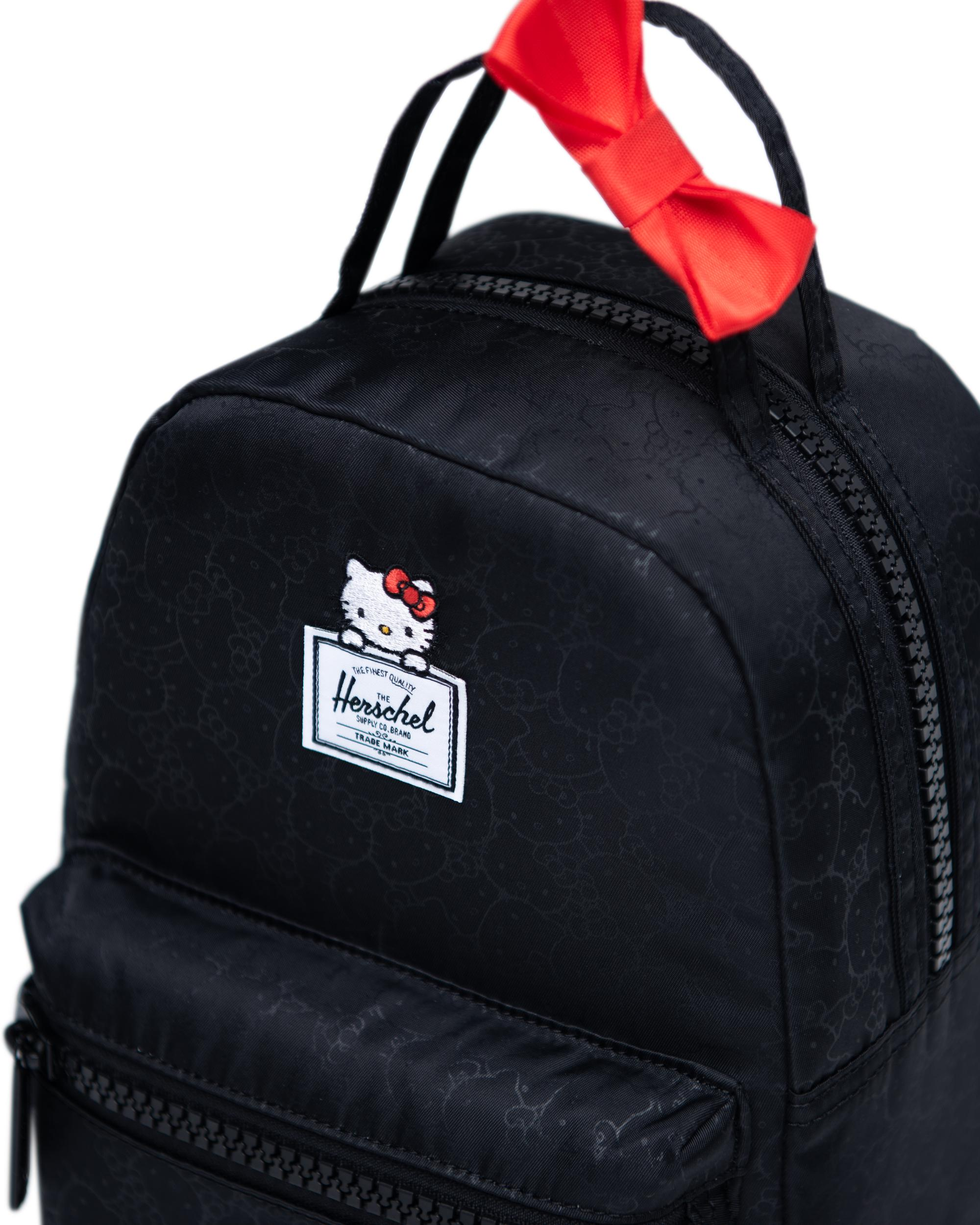 fd7fa2c8495 ... Dual top carrying handles with decorative Hello Kitty bow ...