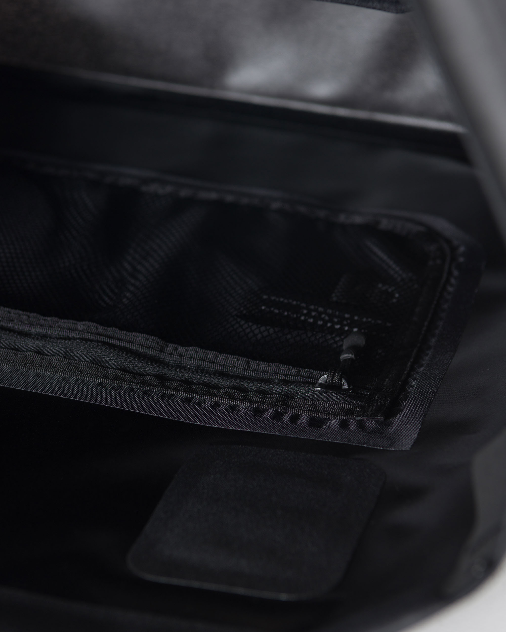 ... Herschel Supply Studio branding  Interior zippered mesh sleeve and die- cut key loop e97a47516b3c2